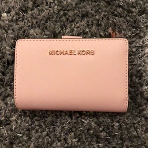 Soft pink Michael Kors leather wallet.